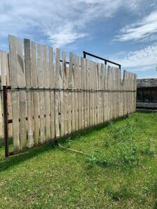 "*30' free-standing windbreak panels made with 3"" pipe and 8 ft boards"