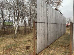 "*30'6"" free-standing windbreak panels made with 2.5"" pipe and 8 ft boards"