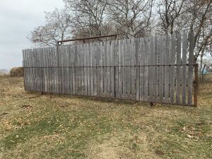 "*30' free-standing windbreak panel made with 3"" pipe, 8' boards inserted"