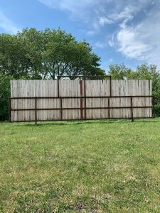 "*29' free-standing windbreak panel made with 3"" pipe and 8 ft boards"